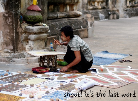 artist selling his wares outside temple