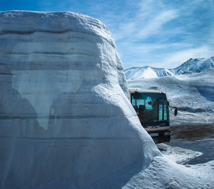 bus and snow wall