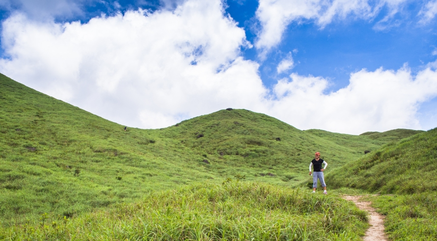 green hills, blue sky and white clouds
