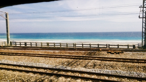 the coast from inside train