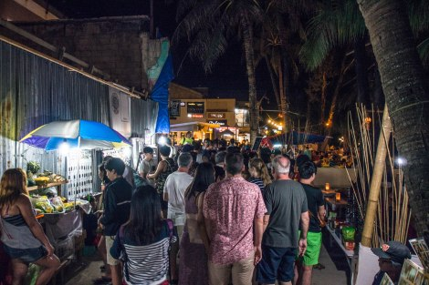 crowd along white beach on a typical night
