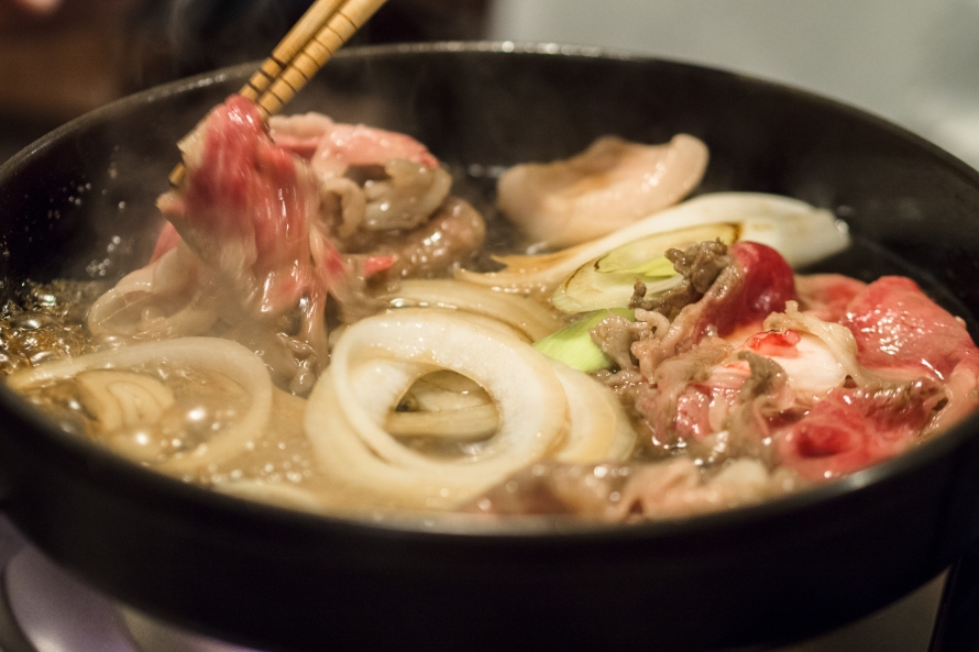 the beef is cooked in a sweet broth